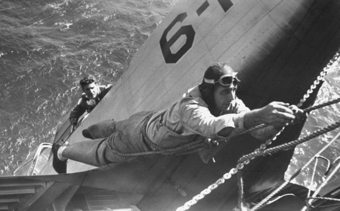 Navy pilot being rescued from