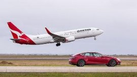 Tesla car races Qantas airliner
